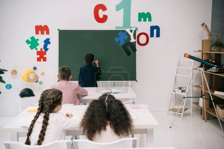 Schoolkids studying in classroom