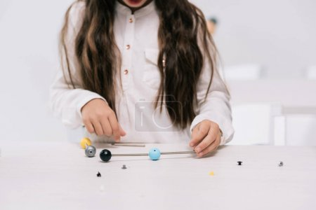 Schoolgirl with molecular model