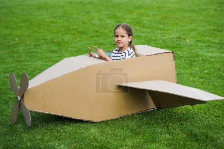 Girl playing with plane in park