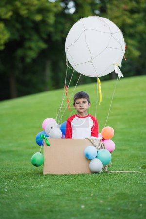 Boy playing with air balloon