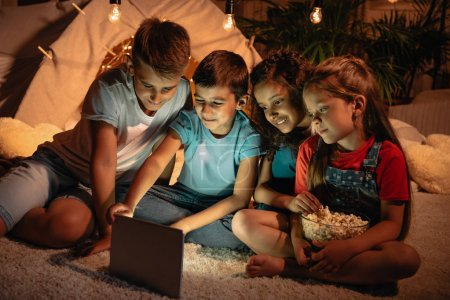 kids using tablet at home