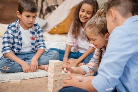 children playing blocks wood game