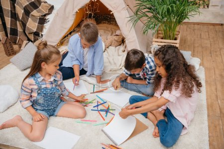 multiethnic kids drawing at home