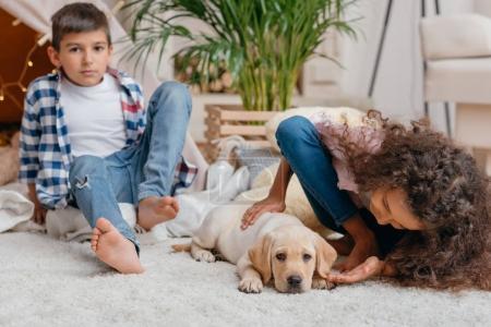 Multiethnic children with labrador puppy