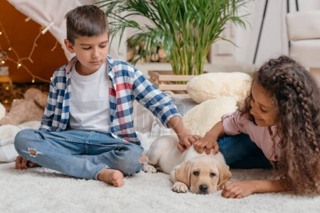 multicultural children with labrador puppy