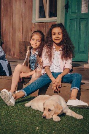 multiethnic girls with puppy