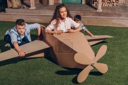 african american girl in cardboard airplane