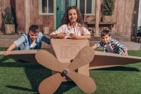 african american girl in cardboard airplane