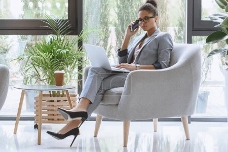 african american businesswoman talking on smartphone