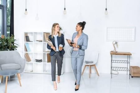 multicultural businesswomen in office