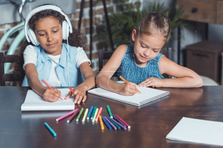 multicultural girls drawing pictures