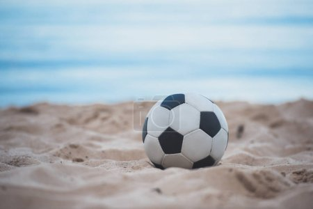 Photo for Close up view of soccer ball on summer sandy beach - Royalty Free Image