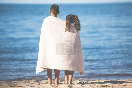 boy and girl on seashore