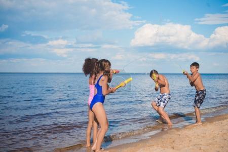 Children playing at seaside