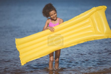 african american girl with inflatable mattress