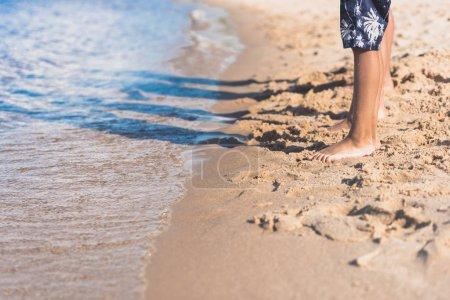 kids standing on sandy beach