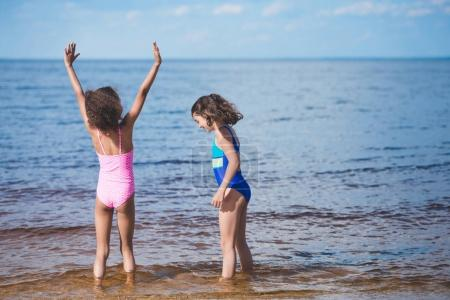 Girls playing at seaside
