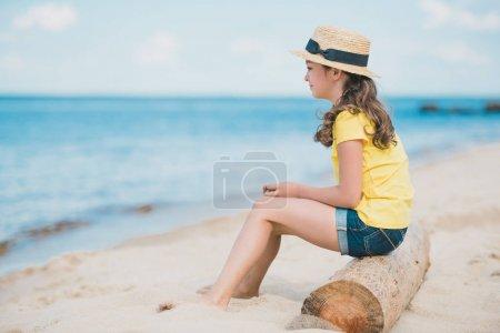 little girl sitting on beach