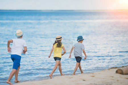 Kids walking on beach