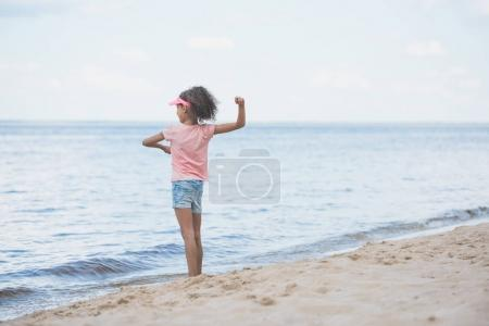 african american girl playing at seaside