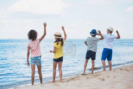 kids throwing stones at seaside
