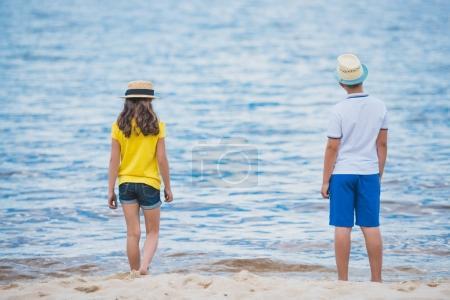 children resting at seashore