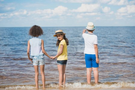 girls and boy at seaside