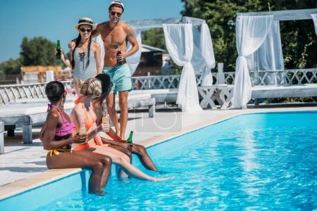 multiethnic peope near pool at resort