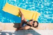 woman near swimming pool at resort