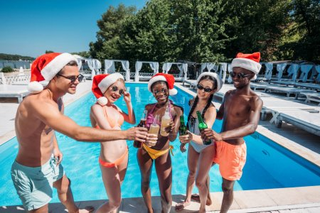 Multiethnic people at Christmas pool party