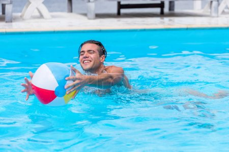 Man with ball in pool