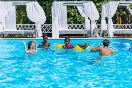 multiethnic people in swimming pool