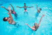 multiethnic people in swimming pool