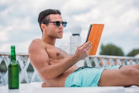 Caucasian man resting at resort
