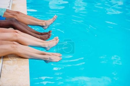 people lying near swimming pool