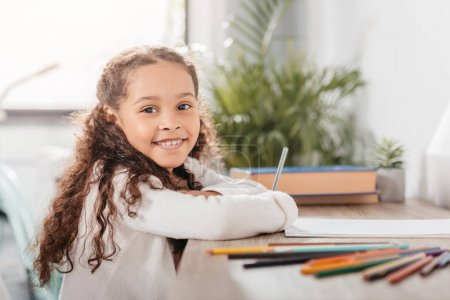 African american girl drawing at home