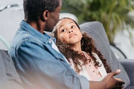 Photo for Portrait of african american father sitting together with daughter at home - Royalty Free Image