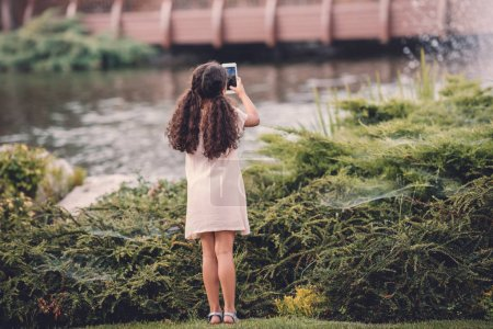 girl taking photo on smartphone