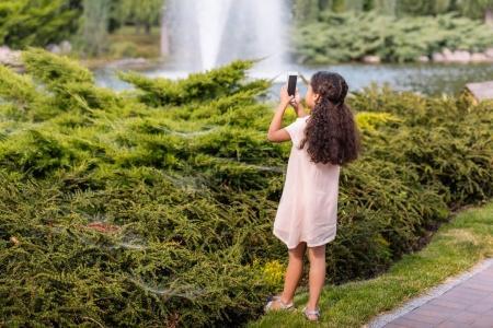 girl taking photo on smartphone