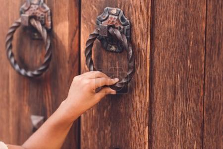 Hand knocking in door