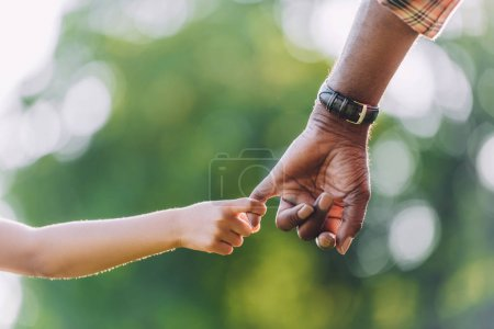 Photo for Cropped view of african american grandfather holding hands with little granddaughter - Royalty Free Image