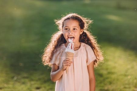 girl licking ice cream