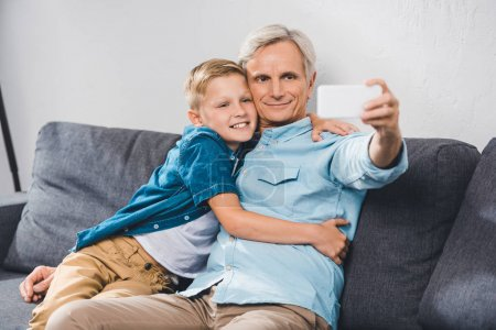 grandfather and grandson taking selfie