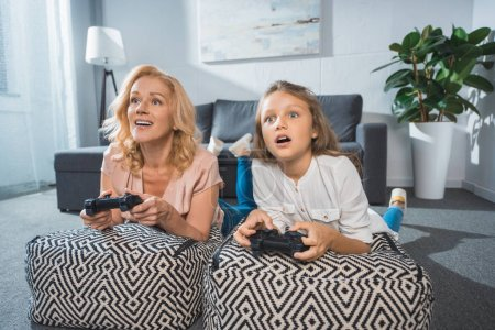 grandmother and granddaughter with joysticks