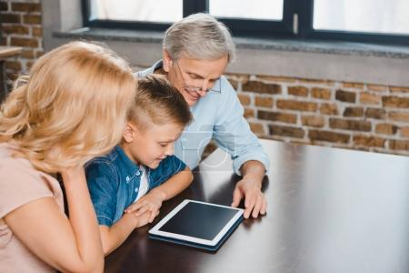 family using digital tablet