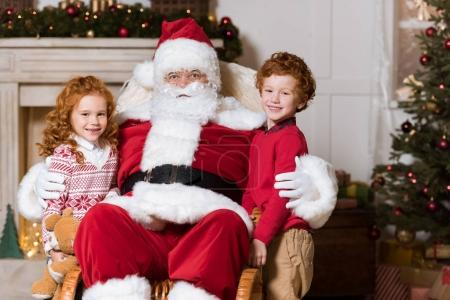 santa claus and little siblings