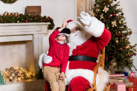 Santa claus and kid in vr headset