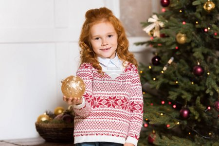 child holding christmas toy