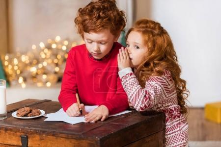 kids writing wish list for santa