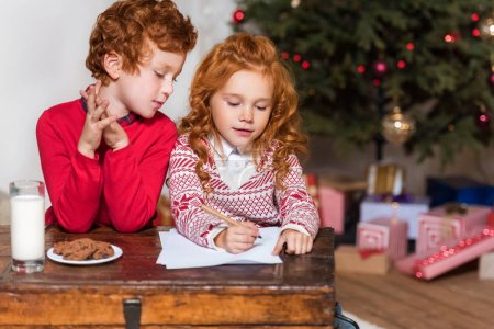 kids writing wish list for santa